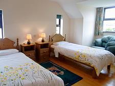 Chambre à deux lits au premier étage